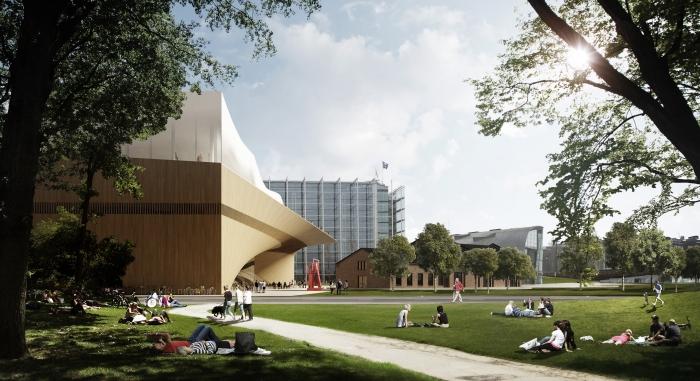 Park před knihovnou nabízí příjemné posezení na trávě