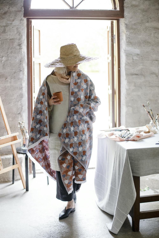 kaste_tablecloth_grey-white_design_anu_leinonen_lempi_scarf_melange_cinnamon_design_team_lapuan_kankurit_tulppaani_blanket_cinnamon-blue_design_helmi_liikanen